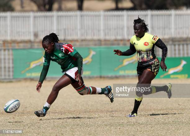 In this handout image provided by the APO Group Sheillah Chajira of Kenya challenged by Claire Anena of Uganda during the Kenya v Uganda Rugby Africa...