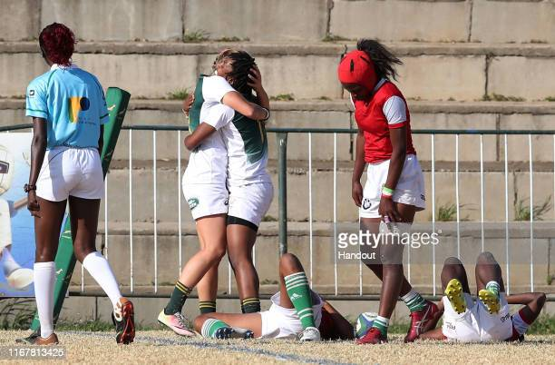 In this handout image provided by the APO Group Snenhlanhla Shozi of South Africa celebrates try with teammates during the Madagascar v South Africa...