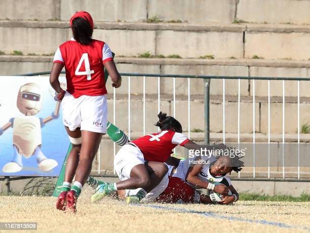 In this handout image provided by the APO Group Snenhlanhla Shozi of South Africa score a try during the Madagascar v South Africa Rugby Africa...