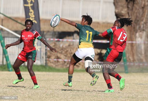 In this handout image provided by the APO Group Snenhlanhla Shozi of South Africa challenged by Celestine Masinde of Kenya during the Kenya v South...