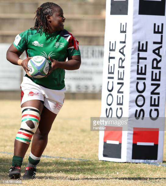 In this handout image provided by the APO Group Stacy Atieno of Kenya celebrates try during the Kenya v Uganda Rugby Africa Women's World Cup match...