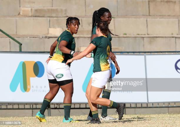 In this handout image provided by the APO Group Tayla Kinsey of South Africa celebrates a try with teammates during the Kenya v South Africa Rugby...