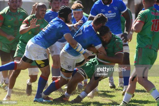 In this handout image provided by the APO Group the physical duels did not miss in this match during the Rugby World Cup qualifier and Rugby Africa...