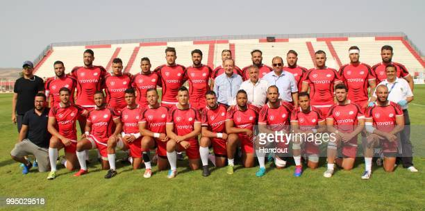In this handout image provided by the APO Group the Tunisian team before the Rugby World Cup qualifier and Rugby Africa World Cup match between...