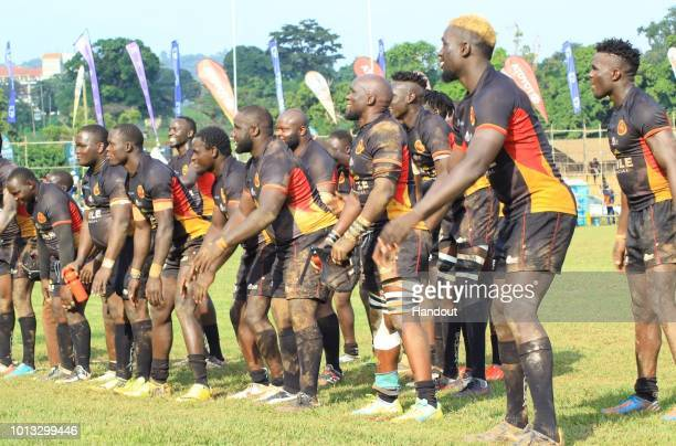In this handout image provided by the APO Group Uganda Cranes dance in applause alongside the fans during the Rugby World Cup qualifier and Rugby...