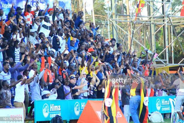 In this handout image provided by the APO Group Ugandan fans in uniform song at the end of the game during the Rugby World Cup qualifier and Rugby...