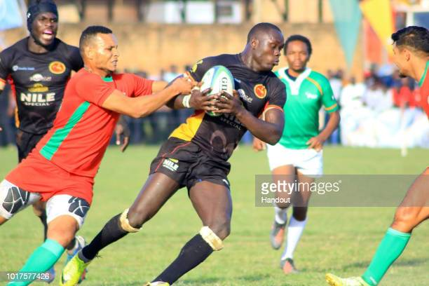 In this handout image provided by the APO Group Uganda's Byron Oketayot is stopped in his tracks by by Moroccan opposition during the Rugby World Cup...