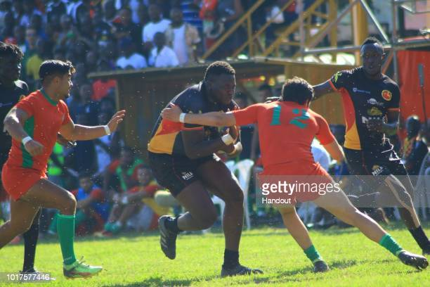 In this handout image provided by the APO Group Uganda's Eliphaz Emong meets opposition during the Rugby World Cup qualifier and Rugby Africa World...
