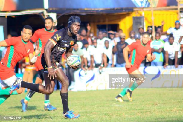 In this handout image provided by the APO Group Uganda's Pius Ogena races to score his second try of the day during the Rugby World Cup qualifier and...