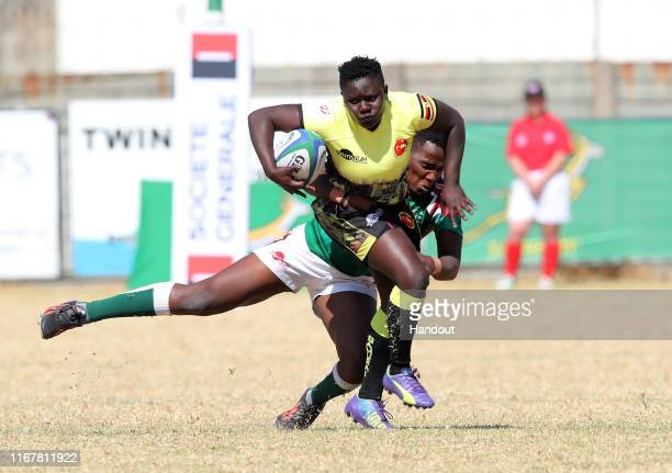 In this handout image provided by the APO Group Yvonne Najjuma of Uganda challenged by Leah Wambui of Kenya during the Kenya v Uganda Rugby Africa...