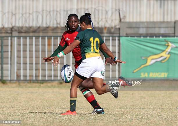 In this handout image provided by the APO Group Zenay Jordaan of South Africa challenged by Sheila Chajira of Kenya during the Kenya v South Africa...