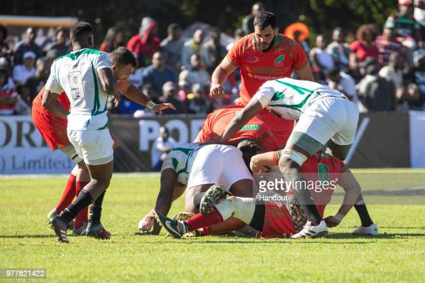 In this handout image provided by the APO Group, Zimbabwe contests Morocco's ruck during the Rugby World Cup qualification and Rugby Africa Gold Cup...