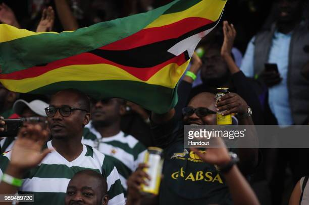 In this handout image provided by the APO Group Zimbabwe fans as Kenya Simbas beat Zimbabwe Sables 4536 during the Rugby World Cup qualifier and...