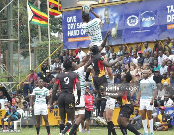 In this handout image provided by the APO Group Zimbabwe's Takudzwa wins a line out during the Rugby World Cup qualifier and Rugby Africa World Cup...