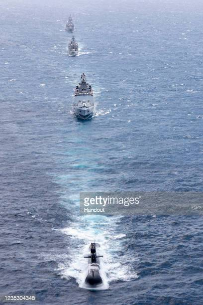 In this handout image provided by the Australian Defence Force, Royal Australian Navy submarine HMAS Rankin is seen alongside Indian Navy ships...