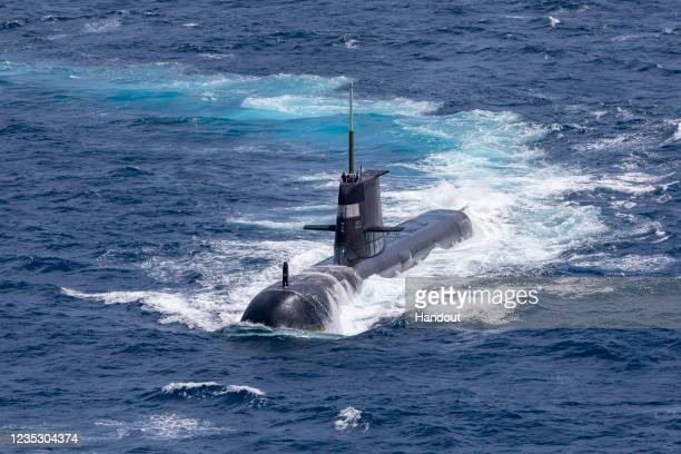 In this handout image provided by the Australian Defence Force, Royal Australian Navy submarine HMAS Rankin is seen during AUSINDEX 21, a biennial...