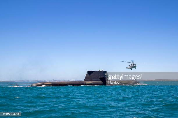 In this handout image provided by the Australian Defence Force, Royal Australian Navy submarine HMAS Rankin conducts helicopter transfers during a...