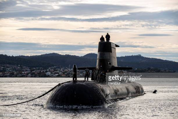 In this handout image provided by the Australian Defence Force, Royal Australian Navy submarine HMAS Sheean arrives for a logistics port visit on...