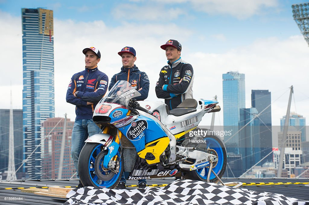 In this handout image provided by the Australian Grand Prix Corporation, MotoGP riders Marc Marquez and Jack Miller and Moto3 rider Brad Binder pose on top of the Melbourne Cricket Ground on October 19, 2016 in Melbourne, Australia.
