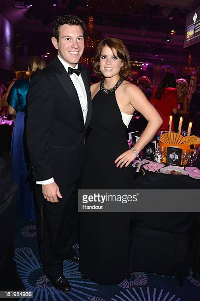 In this handout image provided by the Boodles Boxing Ball Committee, Jack Brooksbank and Princess Eugenie of York pose at the Boodles Boxing Ball...