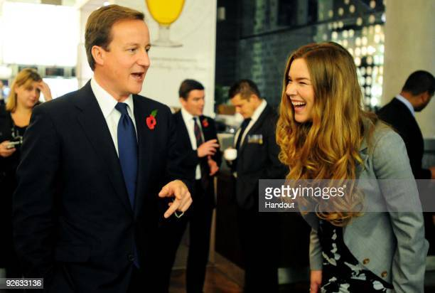 In this handout image provided by the Conservative Party Leader of the Conservative Party David Cameron shares a joke with Joss Stone backstage after...