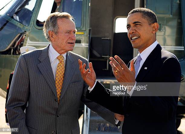 In this handout image provided by the Department of Defense , Former president George H. W. Bush and President Barack Obama arrive before the Points...
