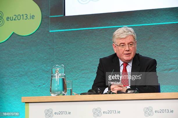 In this handout image provided by The Department of the Taoiseach Eamon Gilmore TD Tánaiste and Minister for Foreign Affairs and Trade attends a...