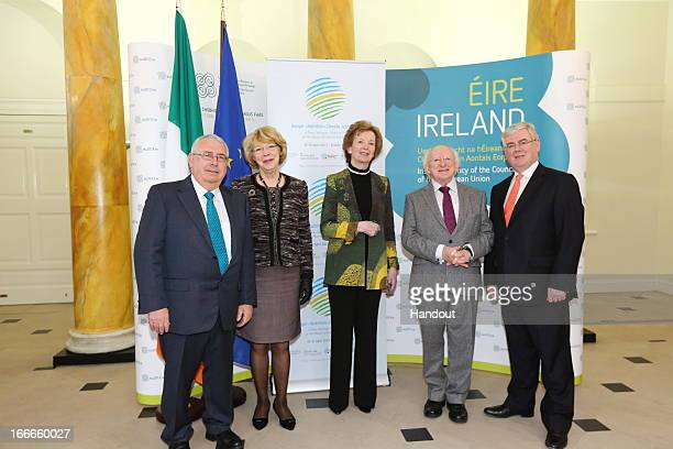 In this handout image provided by the Dept of the Taoiseach Minister of State for Trade and Development Joe Costello Sabina Coyne Mary Robinson...