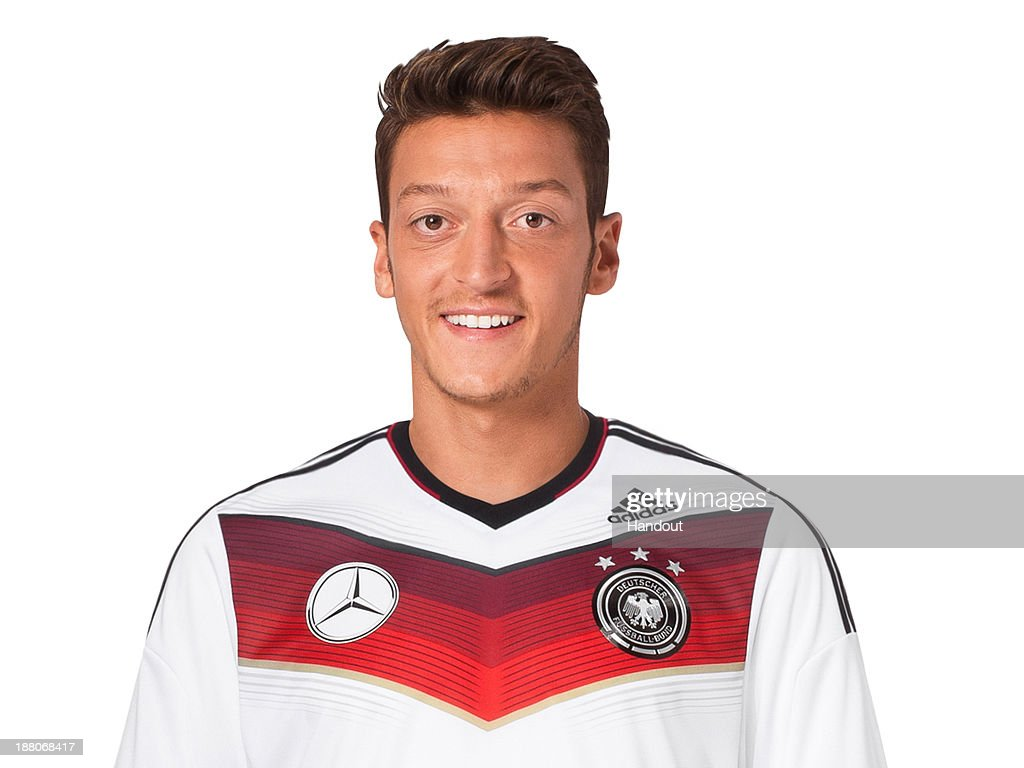 In this handout image provided by the DFB, Mesut Oezil poses during the German National Team presentation on November 15, 2013 in Germany.