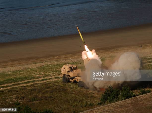 In this handout image provided by the Eighth Army Public Affairs A Continental United States based artillery unit establishes a firing point during...