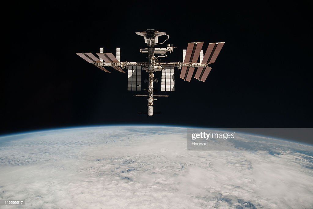 Endeavour Orbits Earth Docked To International Space Station : News Photo
