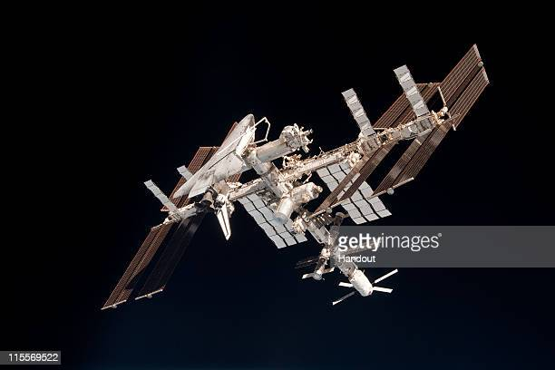 In this handout image provided by the European Space Agency and NASA, the International Space Station and the docked space shuttle Endeavour orbit...