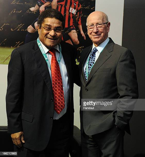 In this handout image provided by The FA, Eusebio and Sir Bobby Charlton pose for a photograph in the FA150 lounge during the Soccerex European Forum...