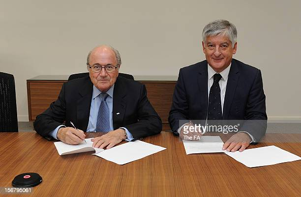 In this handout image provided by The FA, FIFA President Joseph S Blatter and FA chairman David Bernstein jointly sign a Memorandum of Understanding...