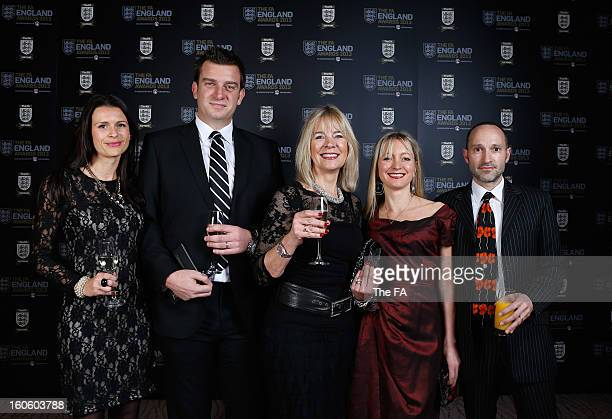 In this handout image provided by The FA, Kelly, Ben and Linda Woolnough pose with Emma and Robin Catto during the FA England Awards 2013 at St....