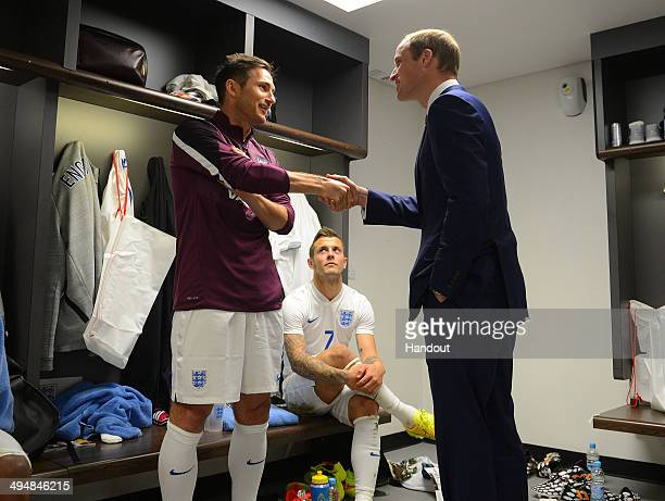 In this handout image provided by The FA President of the Football Association Prince William Duke of Cambridge speaks to England players Frank...