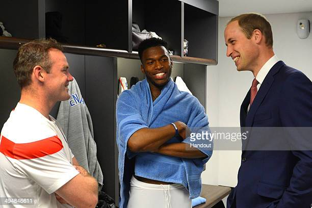 In this handout image provided by The FA President of the Football Association Prince William Duke of Cambridge speaks to England players Wayne...