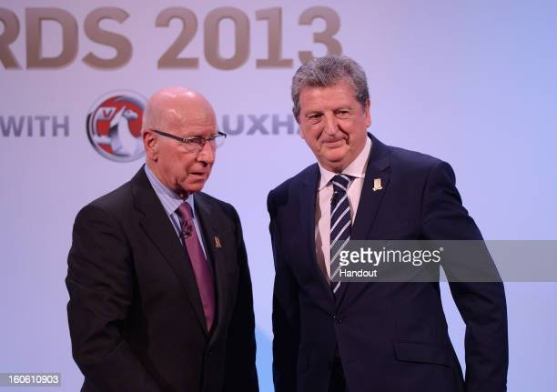 In this handout image provided by The FA, Sir Bobby Charlton and England manager Roy Hodgson appear on stage during the FA England Awards 2013 at St....