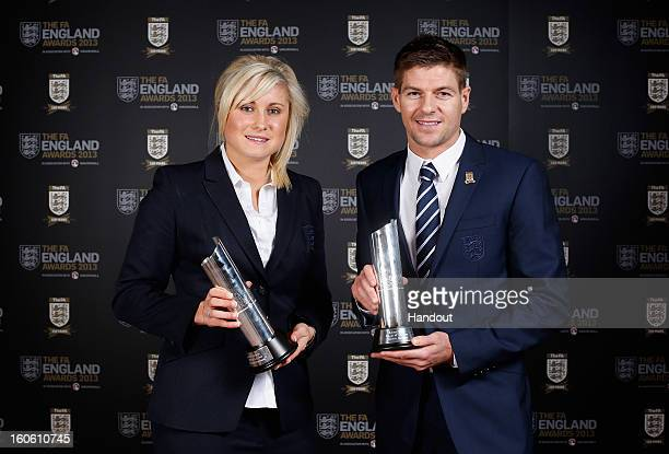 In this handout image provided by The FA Stephanie Houghton poses with the Senior Women's Player of the Year award and Steven Gerrard poses with the...