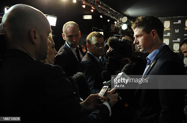 In this handout image provided by The FA, Steven Gerrard speaks to the media in the FA150 lounge during the Soccerex European Forum Conference...