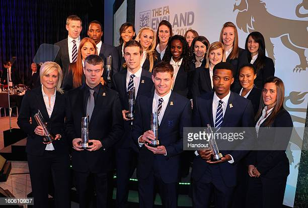 In this handout image provided by The FA Steven Gerrard the Senior Men's Player of the Year poses with fellow award winners during the FA England...