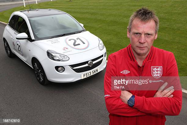 In this handout image provided by The FA Stuart Pearce poses with a special Vauxhall Adam during the England Under 21 Squad Announcement for the U21...