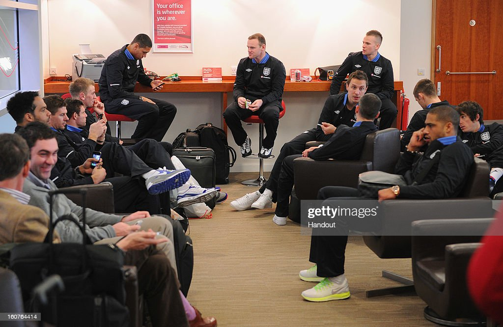 In this handout image provided by The FA, the England squad sit in a waiting room as they travel to London on February 5, 2013 in Birmingham England.