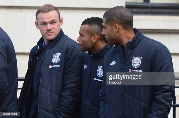 In this handout image provided by The FA, Wayne Rooney, Ashley Cole and Glen Johnson chat as the England squad go for a walk around Mayfair in London...