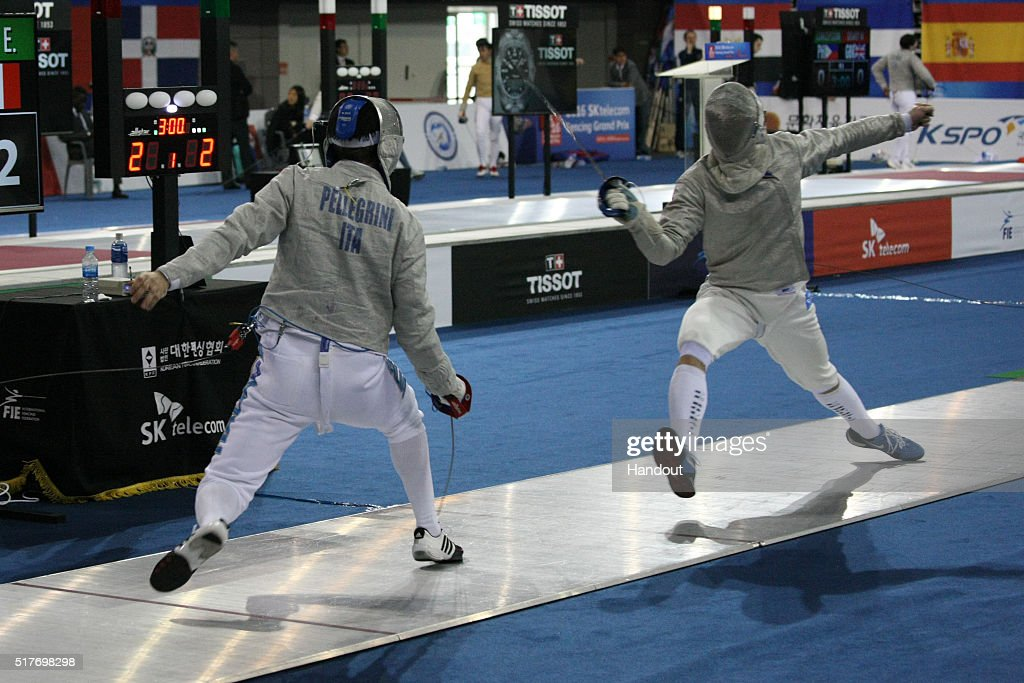In this handout image provided by the FIE, Alberto Pellegrini of Italy and Edward Barloy of France compete during the individual Men's Sabre match during day 1 of the FIE Grand Prix on March 25, 2016 in Seoul, South Korea.