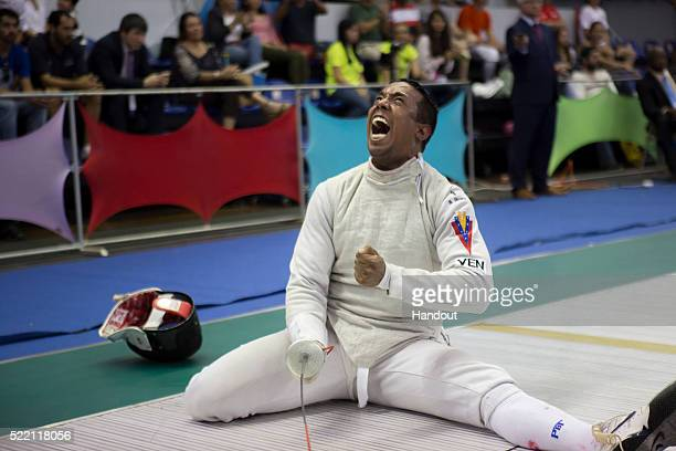 In this handout image provided by the FIE Antonio Leal of Venezuela celebrates during the individual men's foil match and qualification for the Rio...