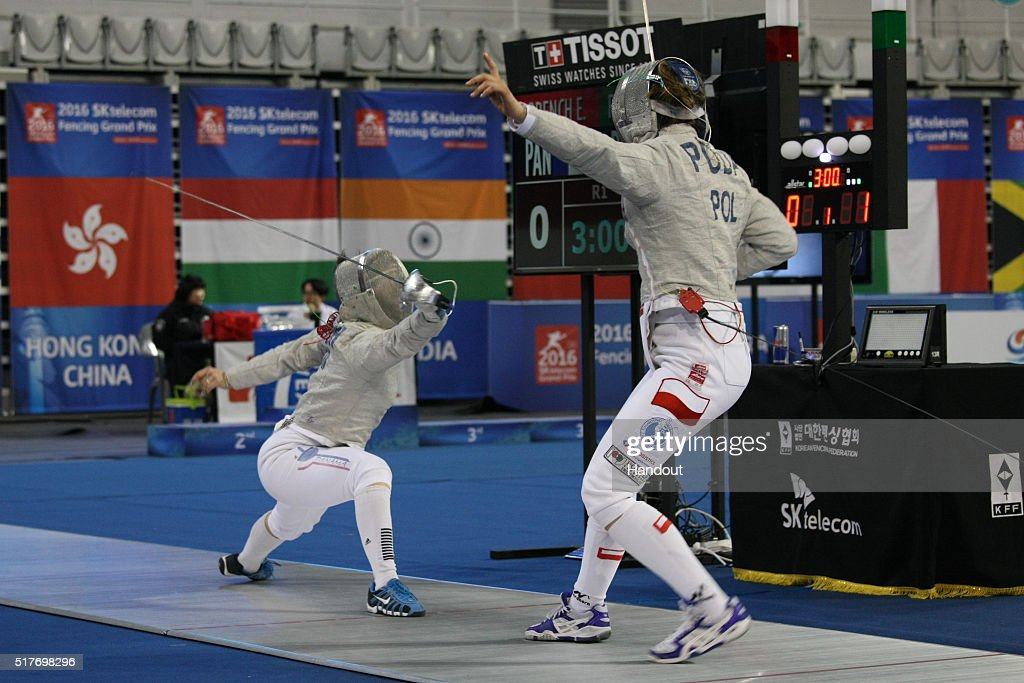 In this handout image provided by the FIE, Eileen Grench of Panama and Puda Marta of Poland compete during the individual Women's Sabre match during day 1 of the FIE Grand Prix on March 25, 2016 in Seoul, South Korea.