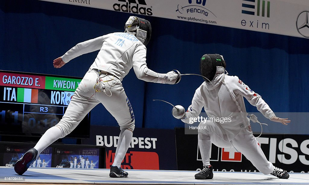 In this handout image provided by the FIE, Enrico Garozzo of Italy and Youngjun Kweon of South Korea compete during the individual men's epee match during day 3 of the WESTEND Grand Prix on March 20, 2016 in Budapest, Hungary.