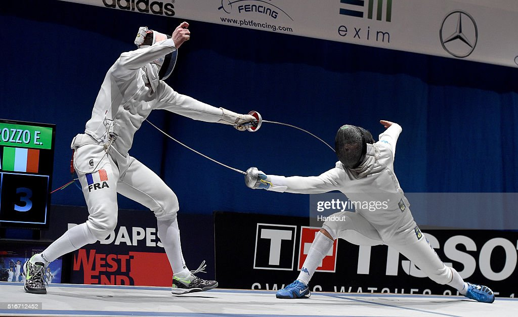In this handout image provided by the FIE, Gauthier Grumier of France and Enrico Garozzo of Italy compete during the individual men's epee final on day 3 of the WESTEND Grand Prix on March 20, 2016 in Budapest, Hungary.