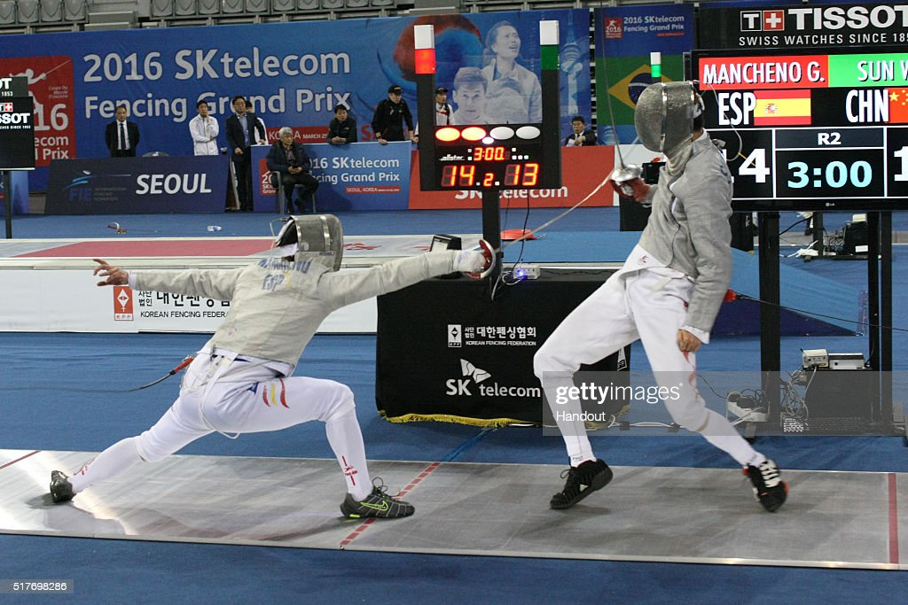 In this handout image provided by the FIE, Guillen Macheno of Spain and Sun Wei of China compete during the individual Men's Sabre match during day 1 of the FIE Grand Prix on March 25, 2016 in Seoul, South Korea.